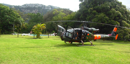 A helicopter on The Outspan Inn's lawns
